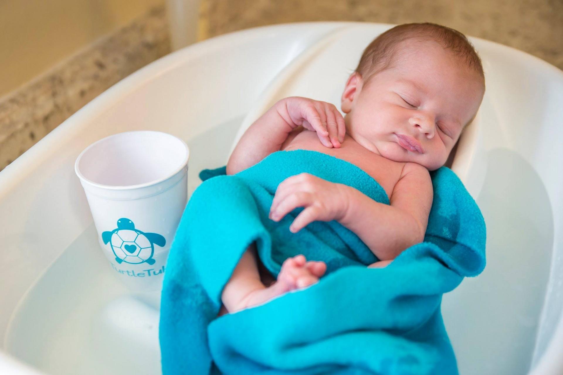 Baby in TurtleTub fleece blanket